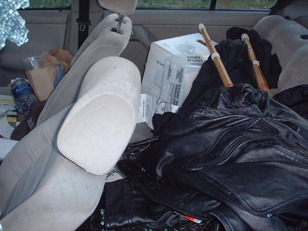 Items, not touched: Leather Jacket, 2 Binders of CDs, brand new Rio SP50 MP3/CD Player, Car Stereo.
